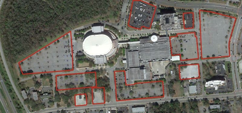 Aerial photo of North Charleston Coliseum with close parking lots outlined in red. It's still not enough — a new $50 million garage is being built to meet parking demand. Source: Google Earth