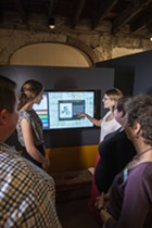 A new touchscreen kiosk explains the history of the house and everyone who lived and worked in it.