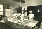Red Cross nurses packing supply bags circa 1940s
