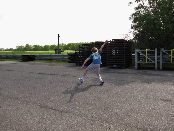 road_bowling-kid_pitching_down_the_road.jpg