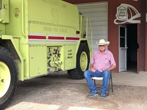 Robert Kennedy sits outside the Cuthand Volunteer Fire Department. - JACOB VAUGHN