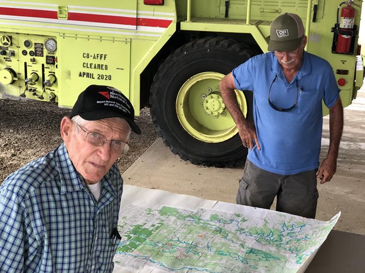 Gary Cheatwood and John Brooks display a map of the propose Martin Nichols Reservoir. - JACOB VAUGHN