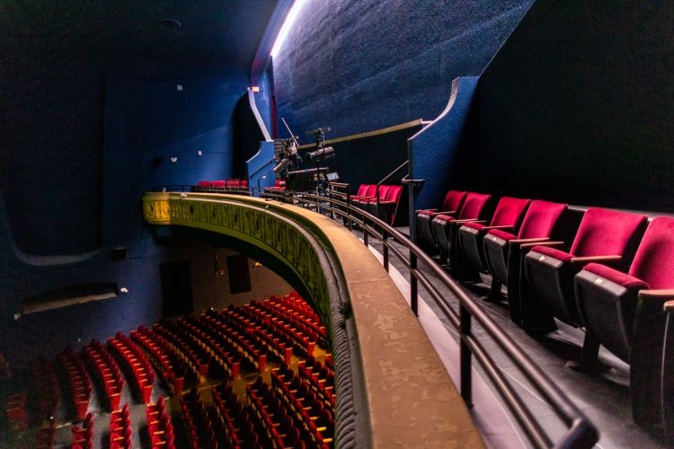 Crews converted the Texas Theatre's second-floor balcony into a second screening room and a row of chairs for the movie house's main screen. - KATHY TRAN