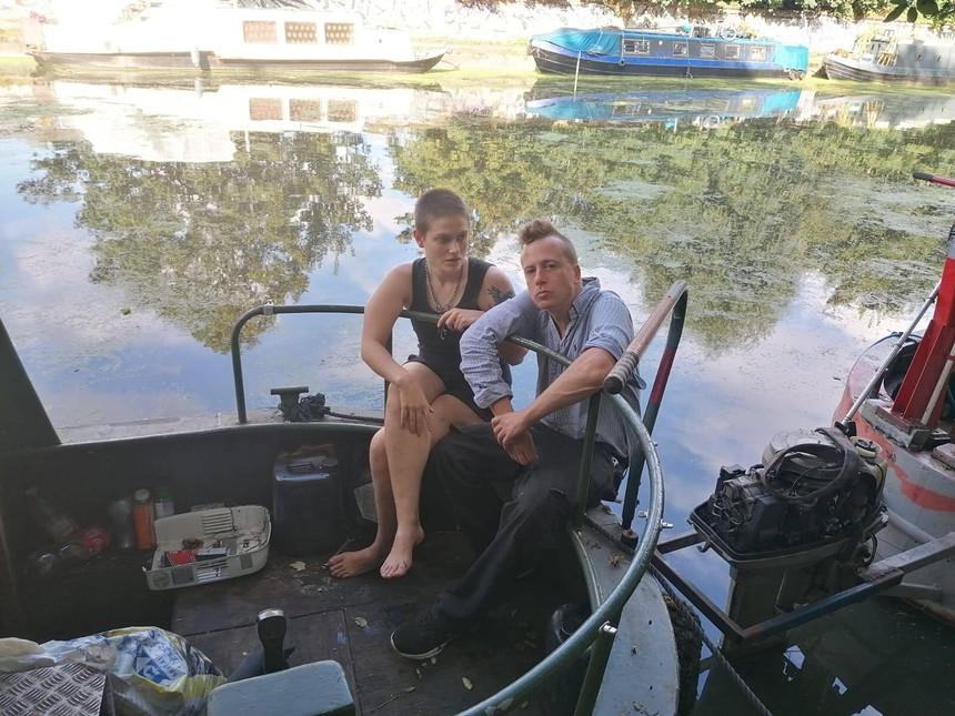 Sylvia Mann and Barrett Brown sit on their London houseboat. - HANNAH JOYSON
