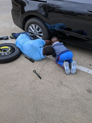 Lewis and his son work on a car together. - COURTESY DALILA REYNOSO