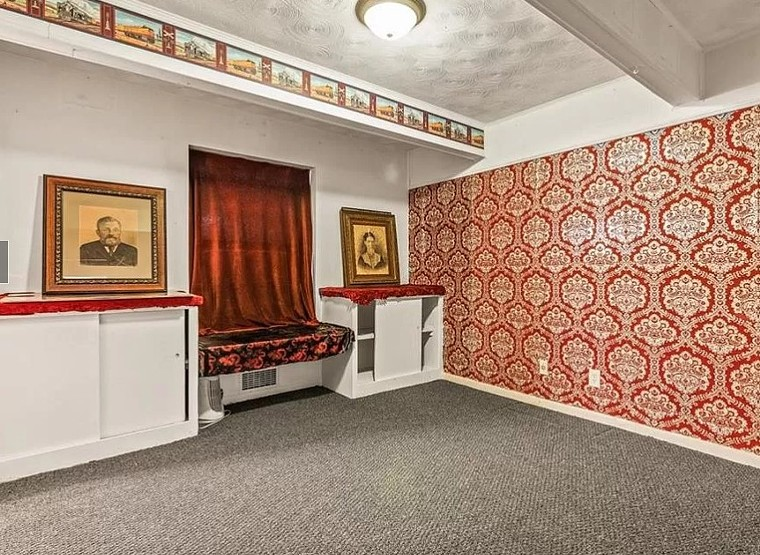 """The home's current owner Robert """"Videobob"""" Moseley says they kept a lot of the home's original 1960s style wallpaper to contribute to their eclectic plans for the interior. - MICHAEL ROUYRE"""