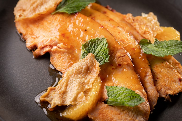 The smoked turkey is served with an apricot chutney and crisped checked skin. - ALISON MCLEAN