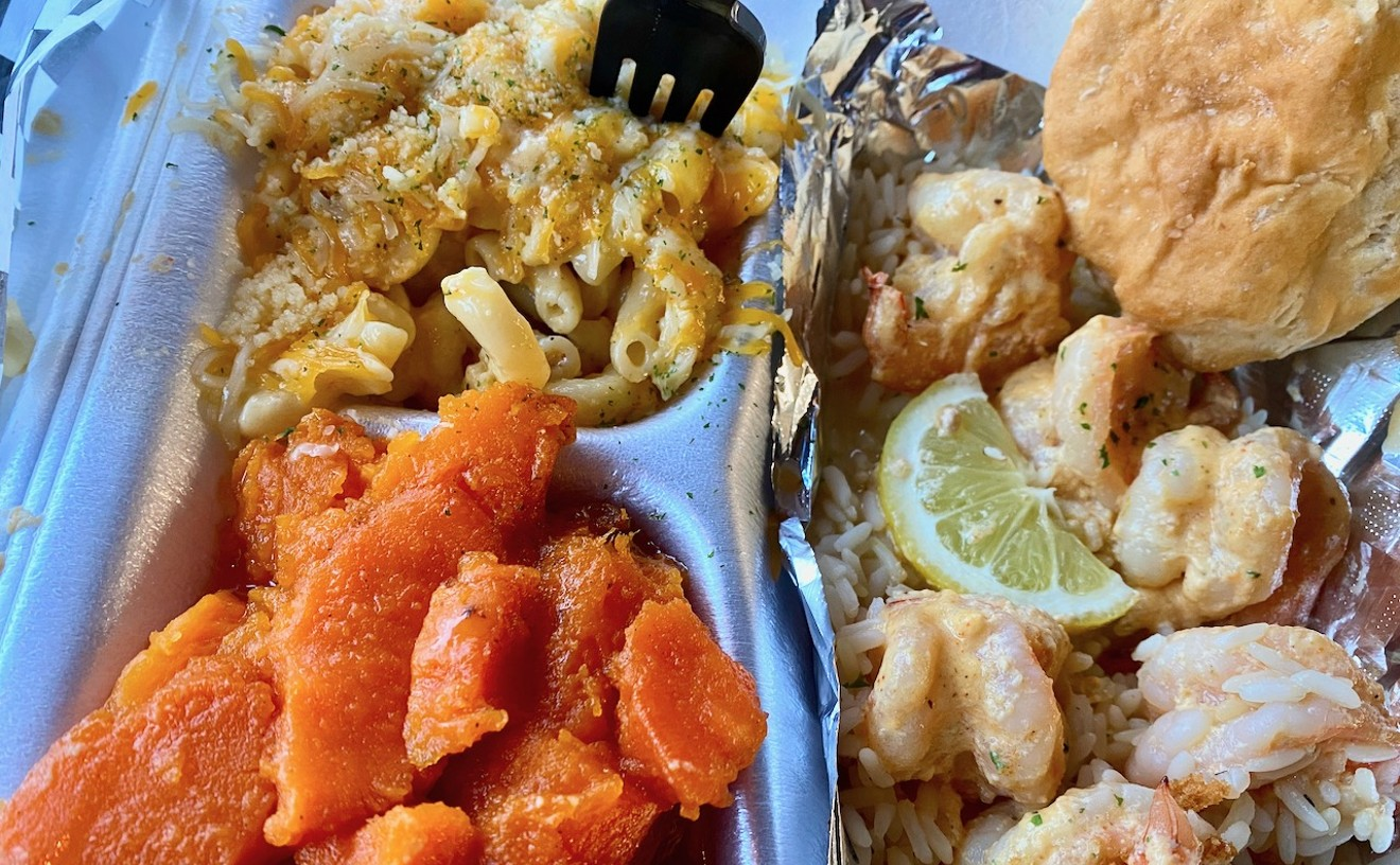 Grilled shrimp over rice with yams and macaroni and cheese