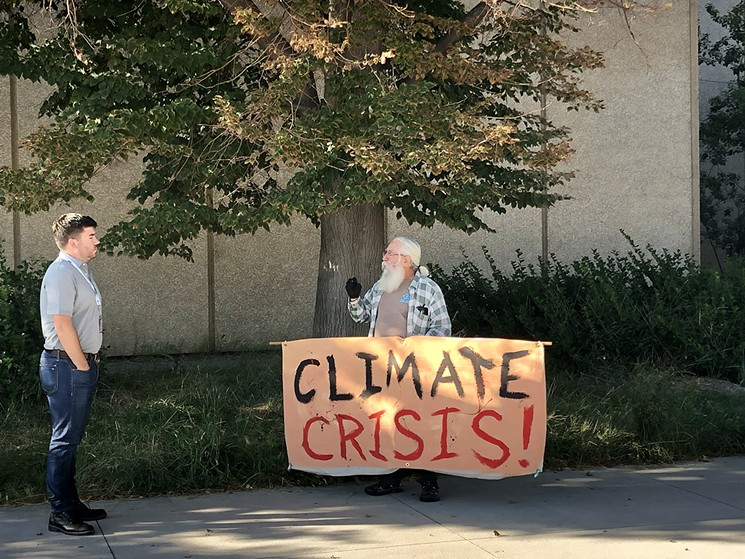 A lone protester stood outside the entrance to the conference. - CHRIS WALKER