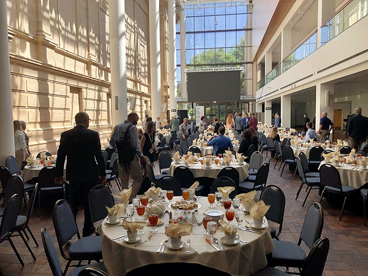 Tables set for lunch at the Museum of Nature & Science. - CHRIS WALKER