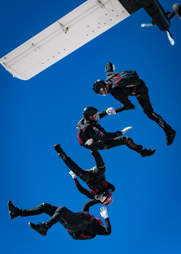 The team competes by forming pictures in midair for points. - COURTESY DITTOE PUBLIC RELATIONS