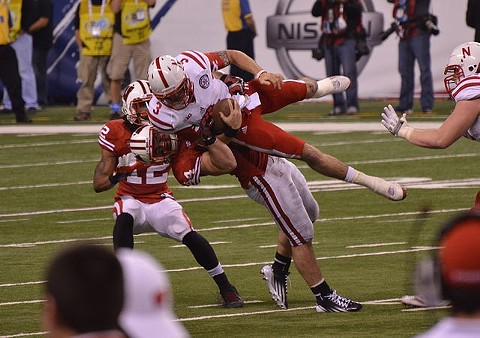 Borland tackles Taylor Martinez during the 2012 Big Ten Football Championship Game. - WIKIPEDIA