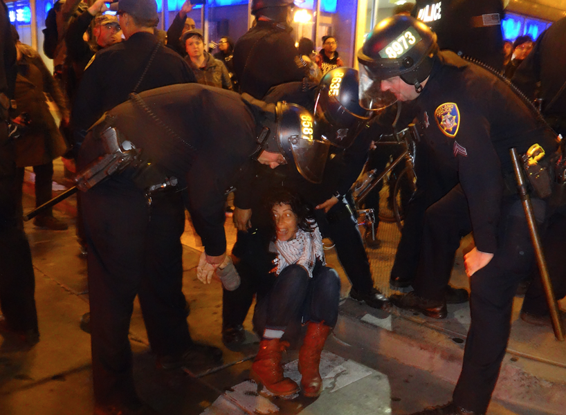 A demonstrator is arrested at Sunday's march against the nighttime protest ban. - DARWIN BONDGRAHAM