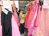 A girl checks out the selection at a recent Princess Project event.