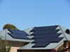 A local energy system could provide incentives for people to cover their roofs with solar panels.
