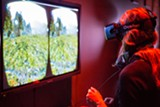 GAYLE LAIRD - A participant tries out the virtual reality tool Oculus Rift at Cognitive Technologies.