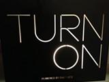 WHITNEY PHANEUF - A sign in the lobby of OneTaste.