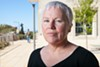 A state labor board has sided with Julie Barrett in her case against UC Berkeley.