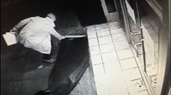 A still from Vinyl's security footage showing Gallagher taking the club's rug.