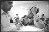 DAVID BACON - A student works with teacher Sal Siino at the Oakland Military Institute. (2003)