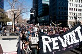 JOHN C. OSBORN - About 1,000 Occupy protesters marched toward the vacant Henry J. Kaiser Convention Center.
