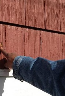 Adam Blueford points out a bullet hole from the night his son was killed.