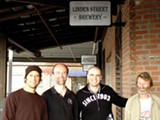 Adam Lamoreaux, second from right, pays attention to history in his clothing and beer.