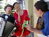 ALEX SAFRON - Adamh Roland and Marie Chang deliver a singing telegram.
