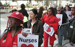 Kaiser Oakland nurses protesting last year. - FILE PHOTO / SAM LEVIN
