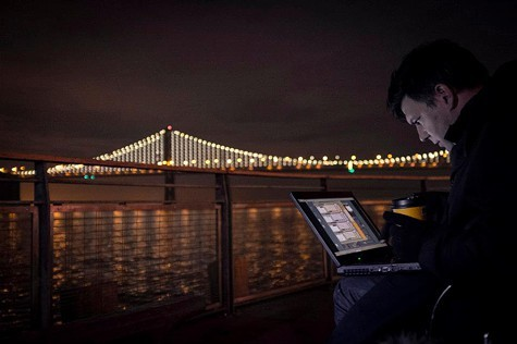 Artist Leo Villareal controls the lights on the Bay Bridge via laptop.