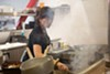 Asuka Nadeshiko, one of the chefs at AS B-Dama, tends the grill.
