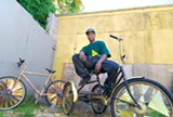 MAYA SUGARMAN - Baby Champ Stevenson and two of his scraper bike creations.