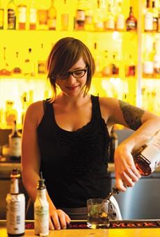 Bartender Britt Petersen makes a mint julep at Picán.