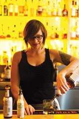 STEPHEN LOEWINSOHN - Bartender Britt Petersen makes a mint julep at Picán.