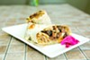 Belly's steak-and-eggs burrito comes with Korean-marinated steak and a runny-yolk egg.