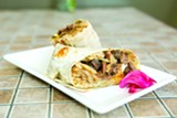 BERT JOHNSON - Belly's steak-and-eggs burrito comes with Korean-marinated steak and a runny-yolk egg.