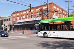 Berkeley merchants say this bus stop has displaced valuable street parking. - BERT JOHNSON