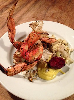 Crab grilled in the fireplace at Camino. - LUKE TSAI