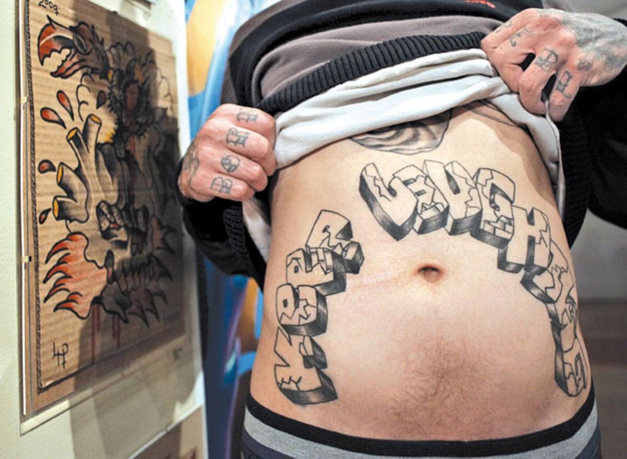12 tattoo designs for black men lace garter tattoo design bullet wound tattoos pictures. Black Bedroom Furniture Sets. Home Design Ideas