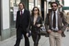 Christian Bale, Amy Adams, and Bradley Cooper star in <i>American Hustle.</i>