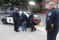 Oakland police officers making an arrest. - DARWIN BONDGRAHAM