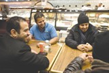 EMILIE RAGUSO - Co-owner Mohsin Sharif and some customers at Oasis Food Market.