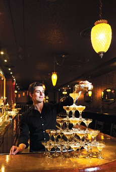 Co-owner Travis Dutton pours a few at his swanky Bar Three Fifty-Five.