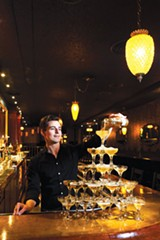 STEPHEN LOEWINSOHN - Co-owner Travis Dutton pours a few at his swanky Bar Three Fifty-Five.