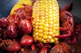 CHRIS DUFFEY - Corn on the cob and crayfish arrive together in a bag, covered in the same hot Cajun spices.