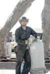 Das Mann operates a crane at 2009 Burning Man.