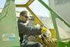Das Mann operates a crane at his West Oakland artist facility.
