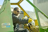 JOSHUA EMERSON SMITH - Das Mann operates a crane at his West Oakland artist facility.