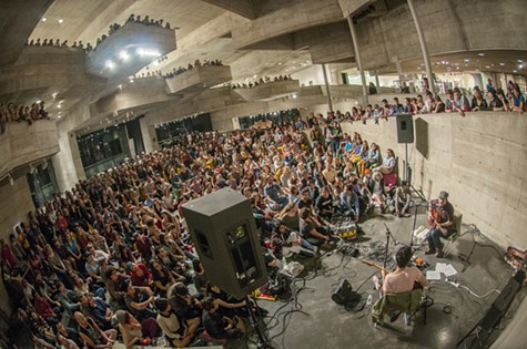 Devendra Banhart and Andy Cabic perform in the BAM/PFA atrium earlier this year. BAM/PFA will close its current doors this Sunday.