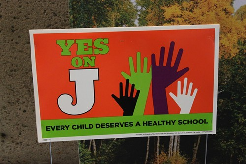 Displayed prominently at the Rethinking School Lunch conference, a sign supporting Measure J, the bond measure that would fund OUSDs proposed school lunch reforms.